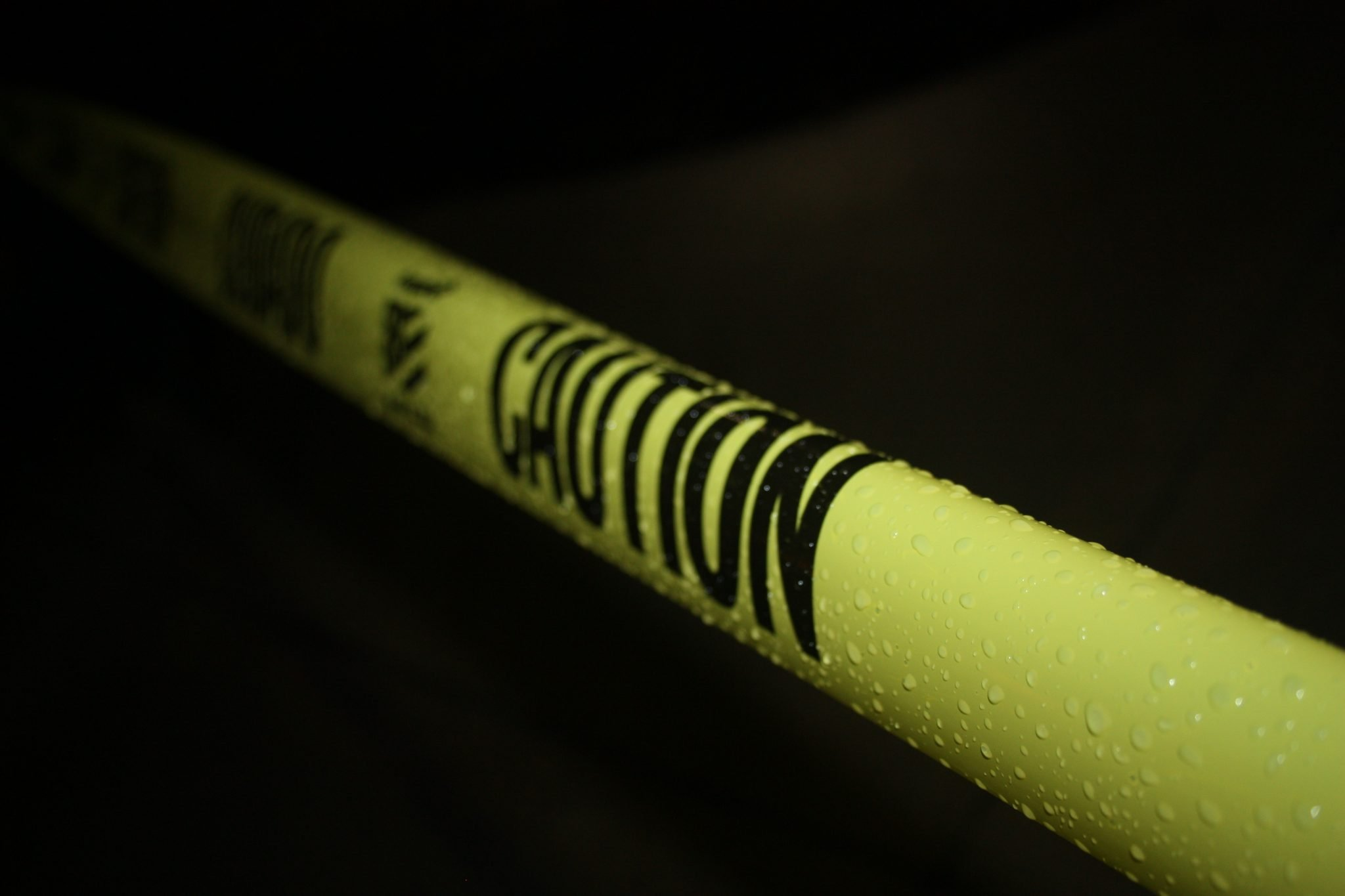 Caution tape on a black background